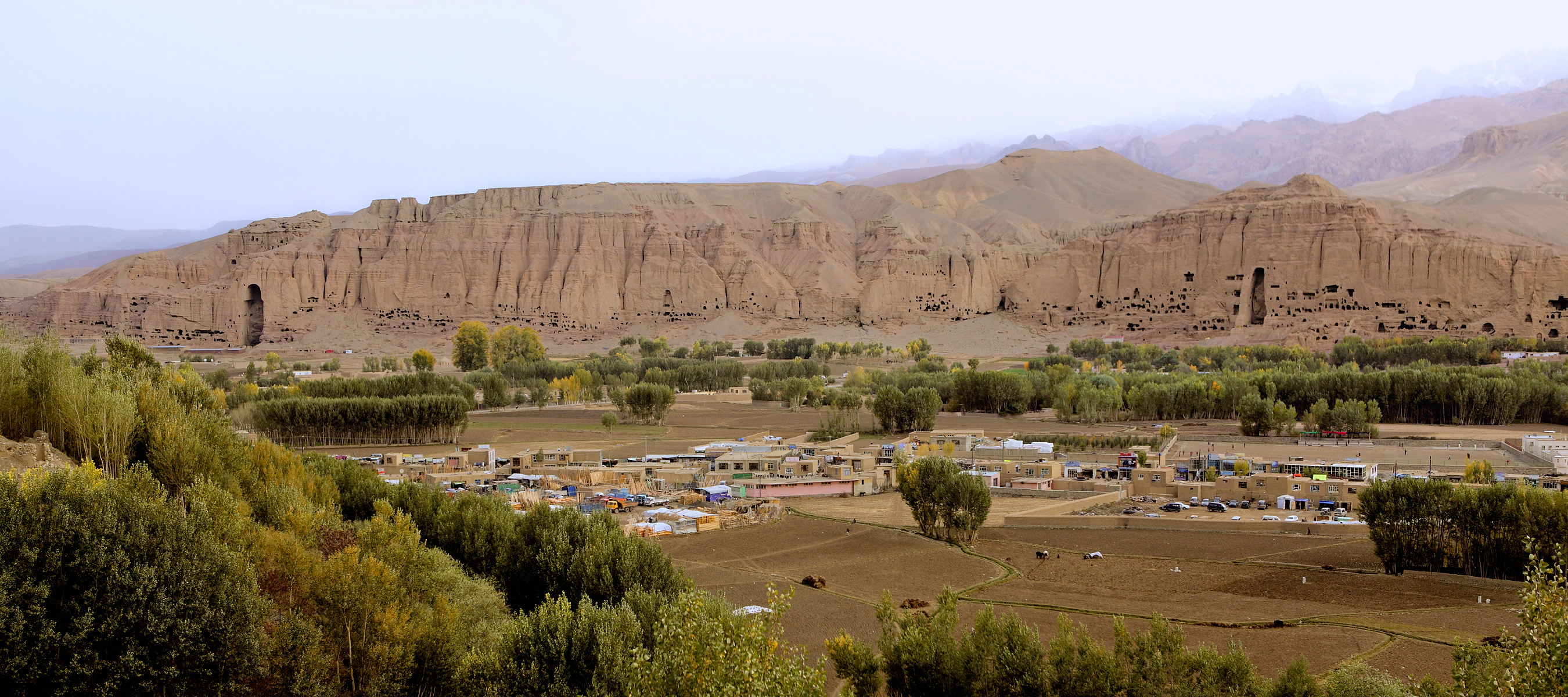 A wide view of Bamiyan Valley in Afghanistan. Bamiyan lies on the Silk Road which lies in the Hindu Kush mountain region, in the Bamiyan Valley. The Silk Road is a caravan route linking the markets of China with those of Western Asia. Until the 11th century, Bamiyan was part of the kingdom of Gandhara. It was a Buddhist religious site from the 2nd century up to the time of the Islamic invasion in the 9th century. Monks at the monasteries lived as hermits in small caves carved into the side of the Bamiyan cliffs. Like Bamiyan valley in this country have thousand of yearÕs historical places and beautiful landscapes. The tourism industry of Afghanistan, developed with government help in the early 1970s, has been negligible since 2001 due to internal political instability. Travel was highly restricted in the country due to the US-led campaign against the Taliban and al-Qaeda. Because of kidnaping and suicidal attack tourism industry had been almost ruined in Afghanistan. After downfall of Taliban regime nowadays Afghanistan can be rebuild its tourism industry. Today World Tourism Organization's slogan should be 'rebuild Afghan tourism for powering sustainable development in Afghanistan'.